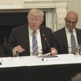 From left, Apple CEO Tim Cook along with Microsoft CEO Satya Nadella and Amazon CEO Jeff Bezos, listen to U.S. President Donald Trump speak during a meeting of the American Technology Roundtable Monday.