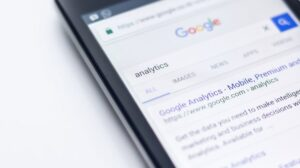 a mobile phone used to diagnose traffic drops using Google analytics Image Source